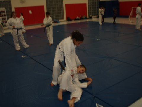 Erika Tucker-Owens throwing Dylan Savage while practicing self-defense