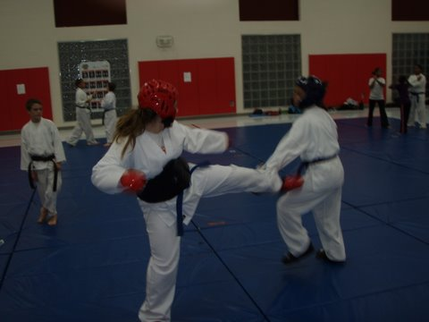 Kayla Johnson and Erika Tucker-Owens sparring